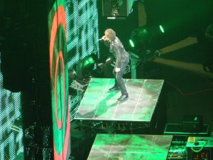 Jon Bon Jovi standing on a video monitor