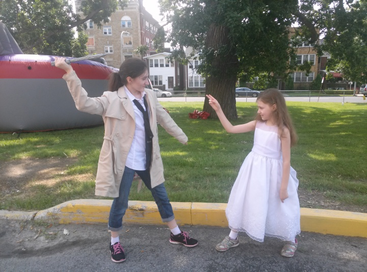 Two girls cosplaying as Castiel and Lilith from Supernatural