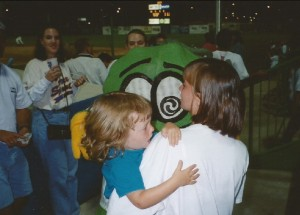 Child crying at sight of pickle mascot