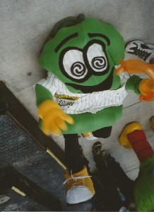 Pickle Mascot on the Ground