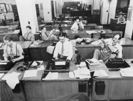 Old photo from New Your Times Newsroom of reporters working, on phone and reading