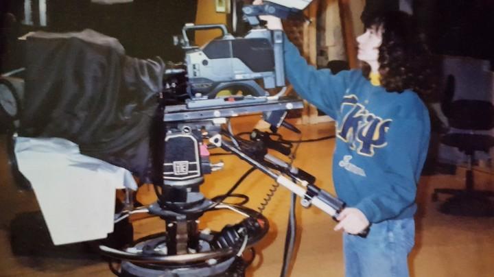 Lorie adjusting a studio camera